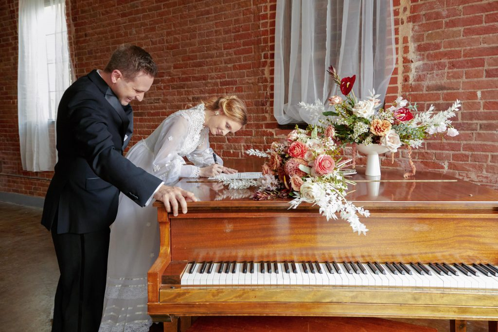 Couple signing marriage certificate